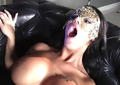 Curvy chick that has a mask on is getting fucked from behind