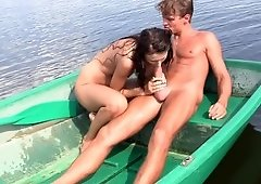 A sexy woman is spending her weekend with three guys on a boat