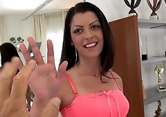 A tall woman removes her clothes and she then sucks a big dick