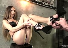 Adorable leggy babe Veronica Clark gives footjob and gets her anus nailed