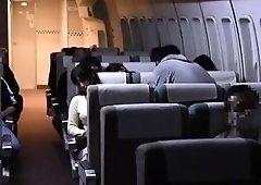 Busty Japanese wife satisfies her desire for cock on a plane