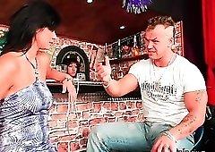 Slut in the bar sucks cock of horny guy