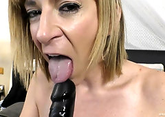 MILF Sara Jay plays with a huge dildo before giving hard head