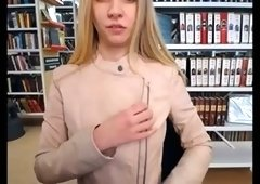 Slim and sexy blonde stripping in public library