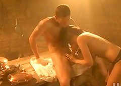 Voluptuous brunette in Medieval hardcore sex on wooden table