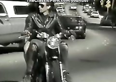 Raven haired sweetie Kimberly Carson rides and sucks big cock of her biker