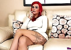 Eye catching redhead Roxi Keogh stripteases and plays with her juicy boobs