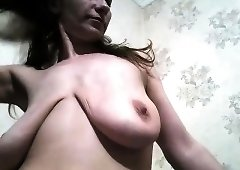 Wild mature brunette plays with her saggy breasts on webcam