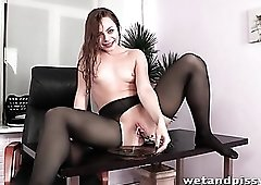 Slippery girl in ripped pantyhose masturbates
