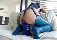 Latex Queen Taking Huge Dildo
