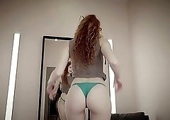 Tall redhead doll takes off her cute green panties