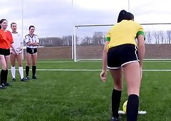 Soccer girls practicing and stripping down on the soccer field