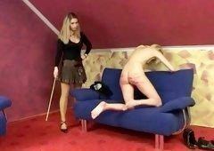 Skinny blonde babe gets her ass punished with a long stick