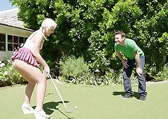 On the golf course he puts the shaft in her hole on the green