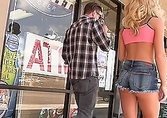 Blonde babe in shorts Katerina Kay sucks a glory hole cock in public