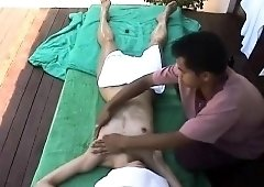 Sexy Indian babe has a masseur fingering her pussy outside