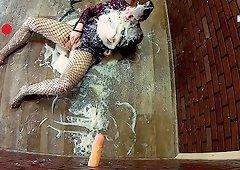 Red haired slut in black fishnets eating slime for dinner