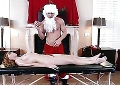 Santa masseur uses his toys and cock to pleasure a client