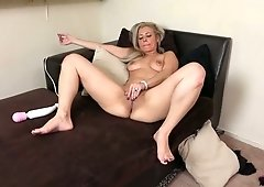 Busty auburn nympho Alana Luv gets emotional while fucking her own twat