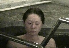 Shower voyeur films on a naked Asian girl with perky boobs