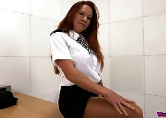 Red haired woman in uniform Faye Rampton shows off her gorgeous assets
