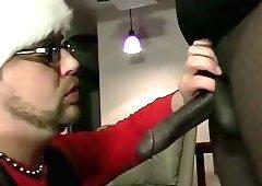 Gay in santa hat giving head to ebony thug