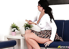 Naughty dark haired gal Kylie K exposes her pink pussy while sitting