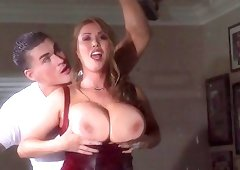 This busty lusty milf is sucking a hard wiener with pleasure
