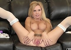 Busty blonde hottie Brooke Tyler poses and toys on the couch