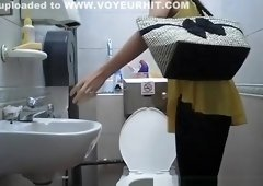 Woman in yellow blouse spied in toilet