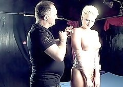 Short haired blonde MILF Scarlet Young tied up and fed a big fat cock
