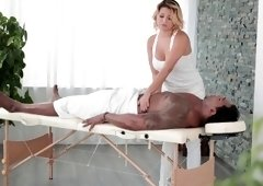 Anna Polina works on & takes a huge black cock on a massage table