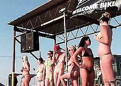 Girls dance and strip at biker rally
