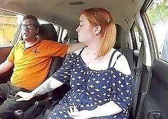 Seduced redhead slowly sucks a dick in the car