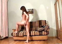 Cutie enjoys her body in a mirror striptease