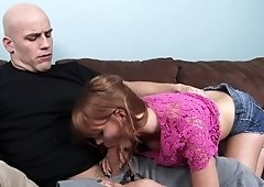 Red haired slut is giving a head
