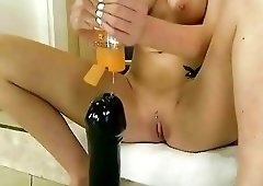 Blonde playing with huge dildo