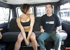 Female bodybuilder Karyn shows her fake big boobs in the back seat